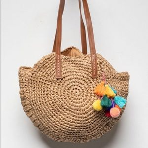Handbags - Adorable round straw bag with tassels